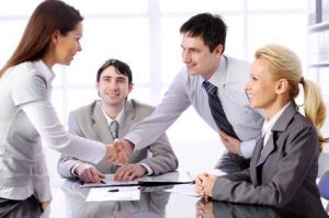 Business partners shaking hands on meeting in the office.