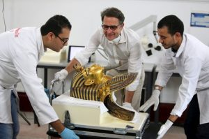 Egyptian and German conservators are pictured during the restoration process of the golden mask of King Tutankhamun at the Egyptian Museum in Cairo